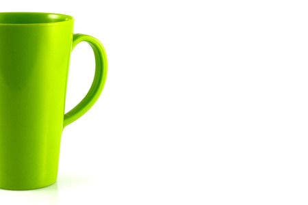 Green plastic cup isolate on white background photo