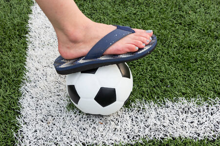Girls sandals Stepping in a football stadium photo
