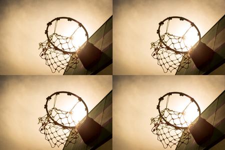 Wooden basketball hoop during sunset. photo