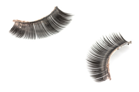 Use of artificial eyelashes macro Isolated on ,Through the use of eyelashes photo
