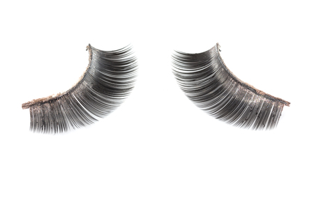 Use artificial eyelashes macro Isolated on ,Through the use of eyelashes photo