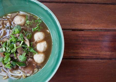 pungent: bowl of pungent thai pork noodle soup