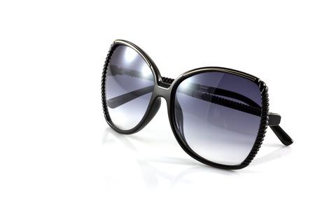 Black fashion sunglasses isolate on white photo