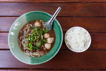 pungent: bowl of pungent thai pork noodle soup with rice Stock Photo