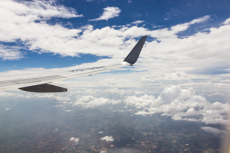 airplan: Blue sky with clouds background on the airplan