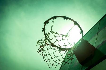 Wooden basketball hoop during sunset.