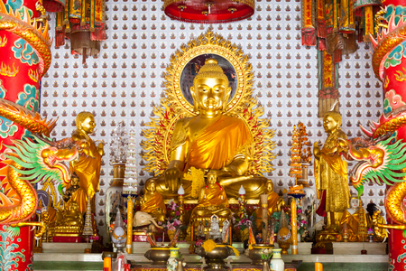 Golden buddha statue in Chinese temple photo
