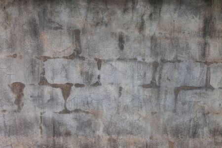 Vintage interior of stone wall and gray cement floor background photo