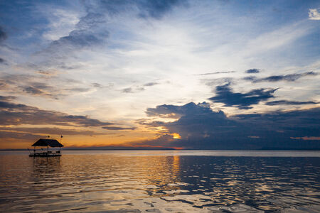 tonle sap: Pontoon floating in the water at sunset Stock Photo