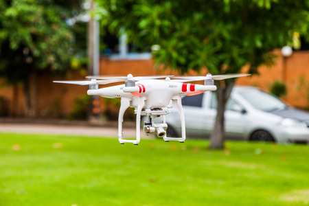 flying drone with camera on the floor prepair to fly photo