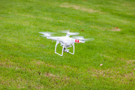 flying drone with camera on the floor prepair to fly