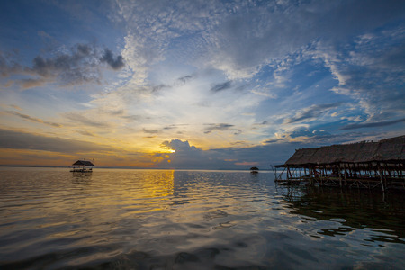 Pontoon floating in the water at sunset, Thailand photo