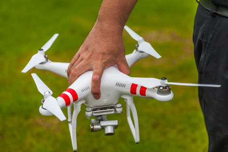 flying drone with camera in hand prepair to fly