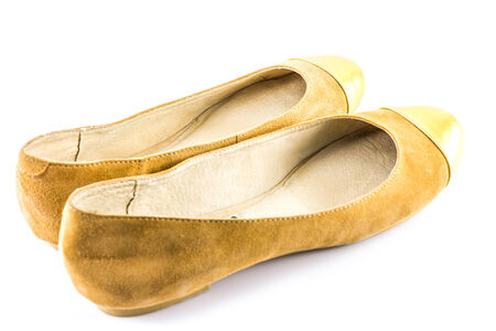 clasp feet: Brown and Gold Shoes on white background