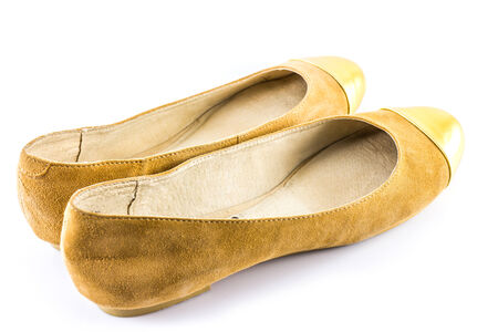 Brown and Gold Shoes on white background photo