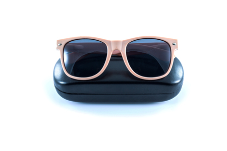 pink sunglasses in black opened case on white background  photo