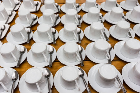 house ware: Many rows of pure white cup of coffee and saucer for seminar