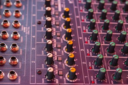 Audio mixing console closeup photo
