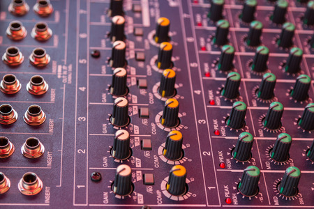Audio mixing console closeup, Tool photo