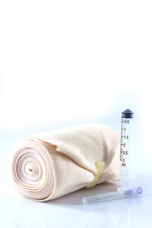 immobilize: Elastic bandage roll on white background Stock Photo