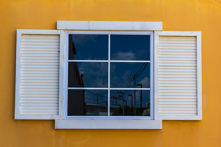 White windows and yellow color wall background photo