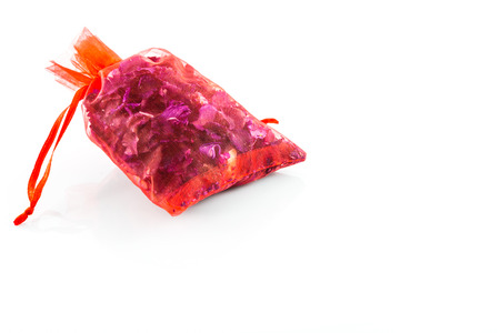 sachets: Dried flowers in a red bag on white background Stock Photo