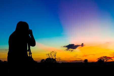 Silhouette photographer with sunset  photo