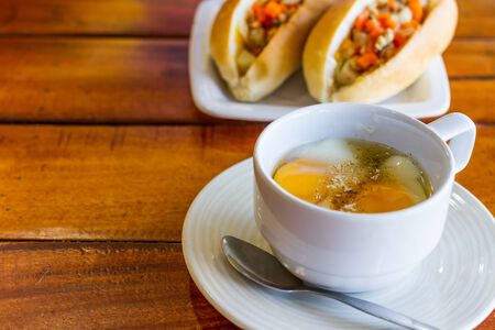 Soft boiled egg in white cup with pepper and spoon morning food photo
