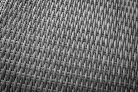 rattan mat: Synthetic rattan texture weaving background as used on outdoor garden furniture. Stock Photo