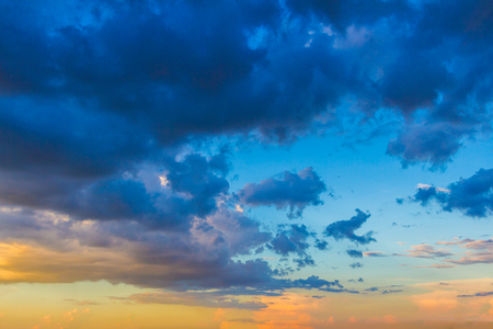 stratus: Dainty wispy pale salmon pink and golden yellow clouds at sunsetbackground Stock Photo
