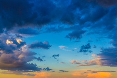 stratus: Dainty wispy pale salmon pink and golden yellow clouds at sunset background Stock Photo