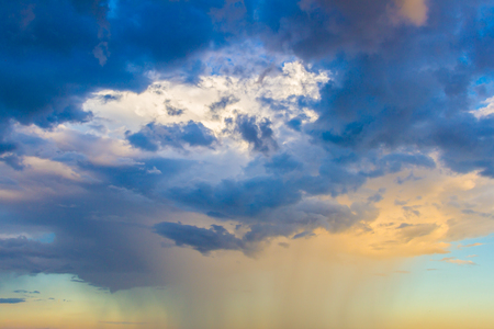 stratus: Dainty wispy pale salmon pink and golden yellow clouds at sunset and raining background Stock Photo