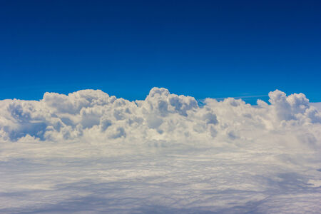 Blue sky with clouds background on the airplan in the morning time Stock Photo