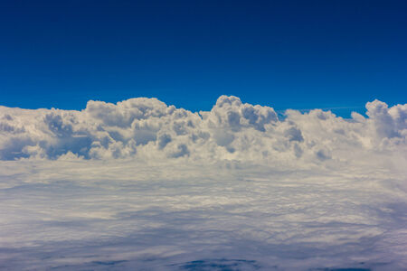 airplan: Blue sky with clouds background on the airplan in the morning time Stock Photo