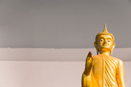 golden Buddha  on gray color  wall background texture photo