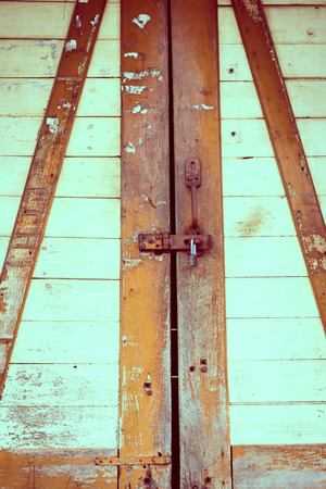 The padlock on an old wooden door background photo