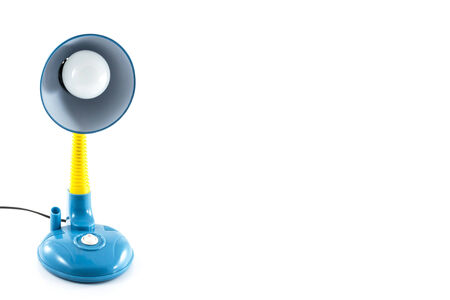 Blue and yellow desk lamp isolated on white background photo