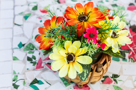 Artificial colorful flowers in wooden vase on white background photo