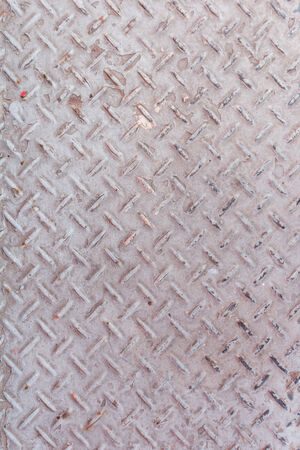 Background of old metal diamond plate in silver color background