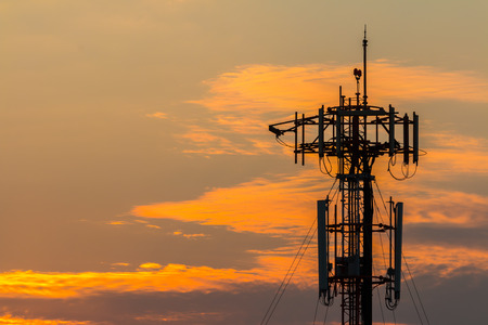 Silhouette Telecommunication tower on sunset   Stock Photo