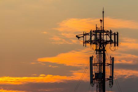 Silhouette Telecommunication tower on sunset   Reklamní fotografie