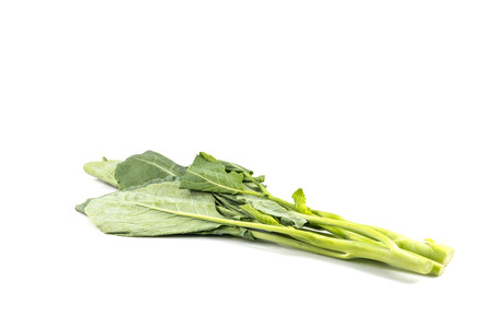 roughage: Fresh Green kale on a white  Stock Photo