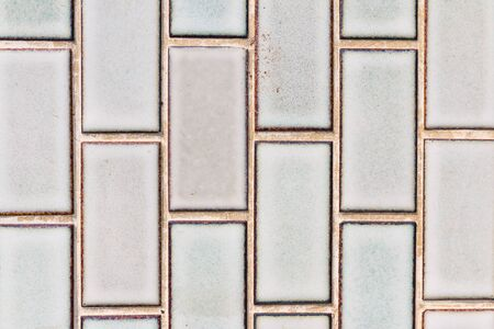 mosaic wall: Old and dirty white mosaic wall background Stock Photo