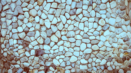 river rock: river rock wall texture background Stock Photo