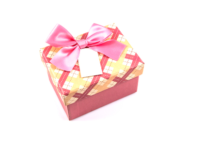 Pink Christmas gift box with pink bow and white tag isolated on white background photo