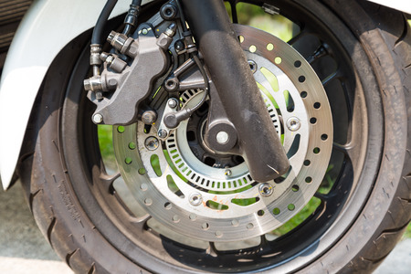 Disc brake of eco motorcycle, , scooter motorcycle background photo
