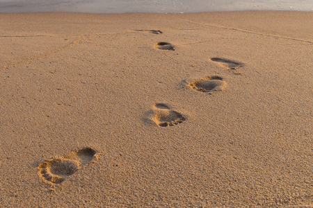 Footprints on the sand beach nature background