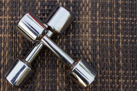 chromed: Chromed dumbbell exercise weights - iron dumbbell for workout Stock Photo