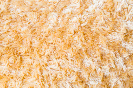 faux: Close up of brown Faux fur fabric synthetical texture background