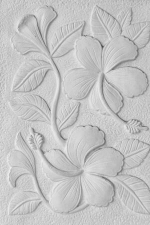 White stone inscription of a China rose, Hawaiian hibiscus, and shoe flower background photo